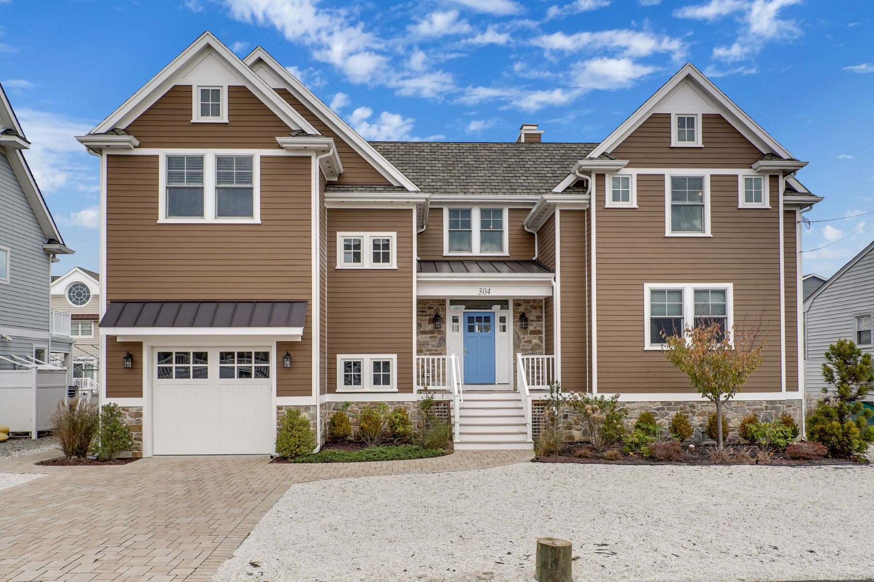 Single Family Homes for Sale at Stunning Custom-Built Lagoon Front Home 304 Schooner Lane, 1, Mantoloking, New Jersey 08738 United States