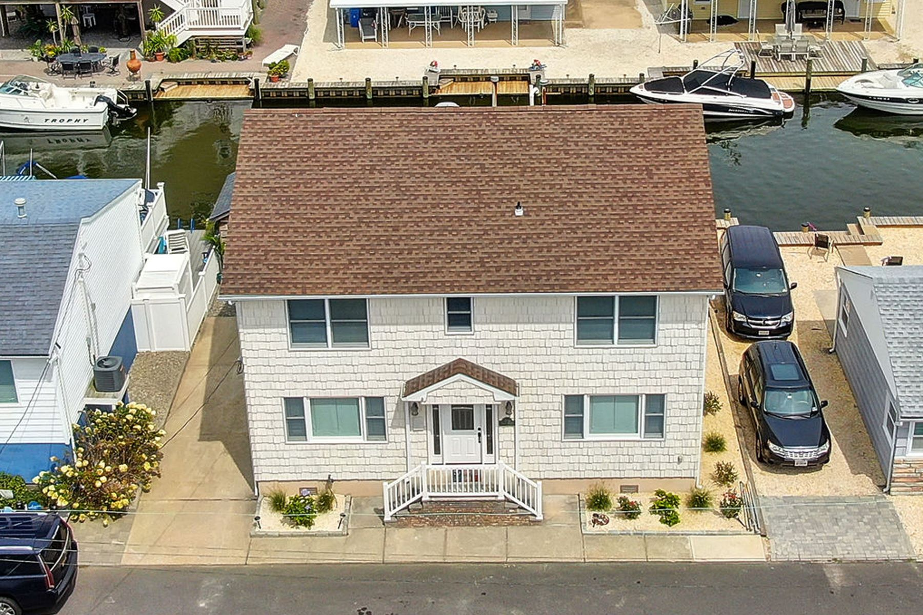 Single Family Homes for Sale at Custom Lagoon Waterfront Home 218 Joseph Street, Lavallette, New Jersey 08735 United States