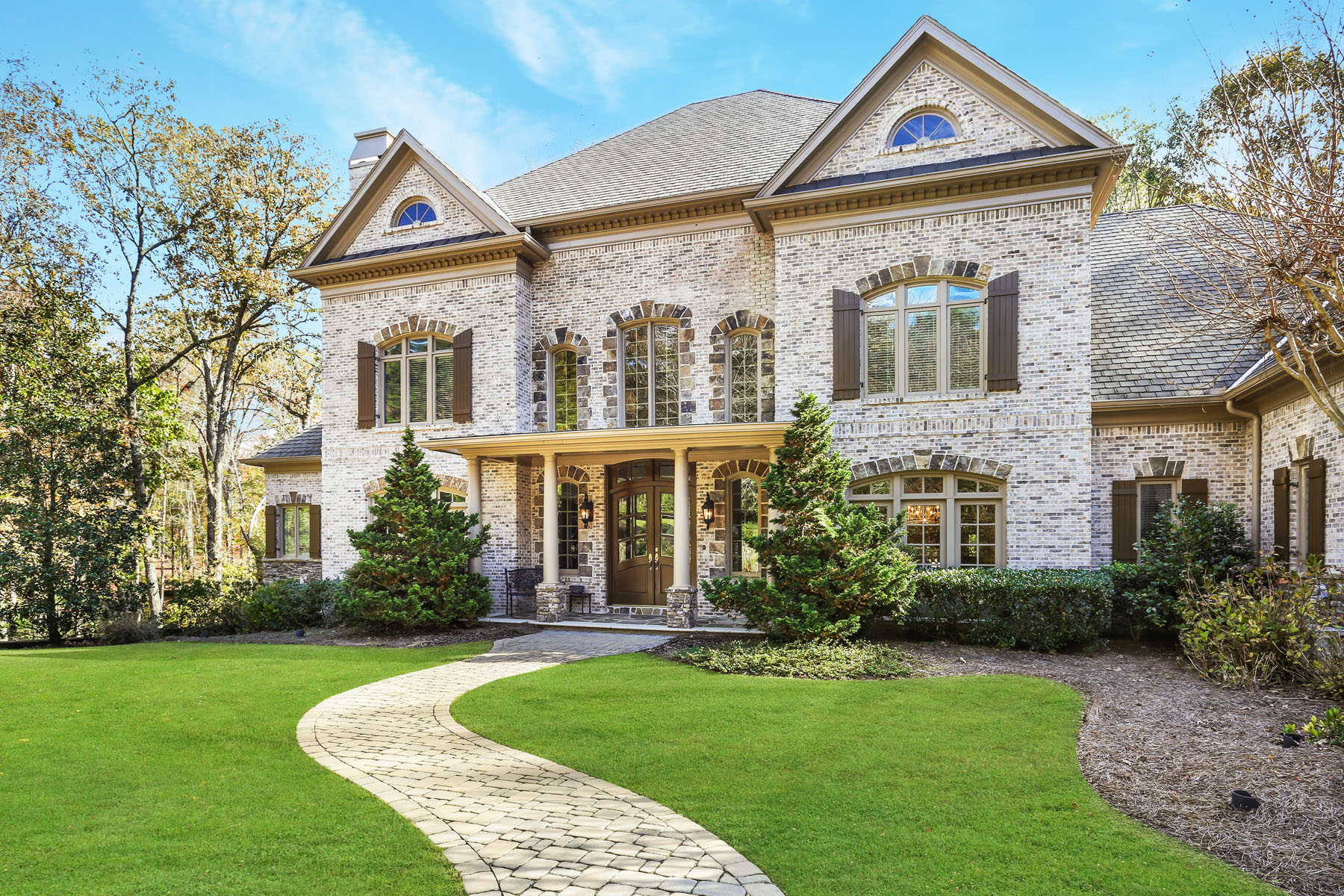 Single Family Homes per Vendita alle ore Exceptional Brick And Stone Estate Home In Country Club Of The South 1000 Downing Street, Johns Creek, Georgia 30022 Stati Uniti